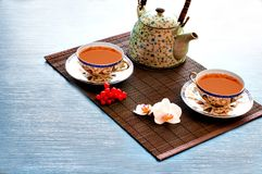 Tea on bamboo Royalty Free Stock Image