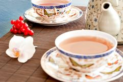 Tea on bamboo royalty free stock photo