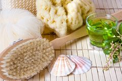 Tea and bath products. Green herbal tea and spa bath products, natural sponge Royalty Free Stock Image