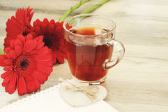 Tea with beautiful flowers Stock Image