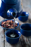 Tea being poured into cup Royalty Free Stock Photo