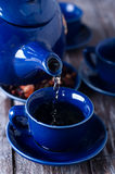 Tea being poured into cup Stock Photo