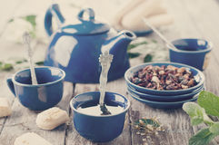Tea being poured into cup. Toned photo Royalty Free Stock Photography