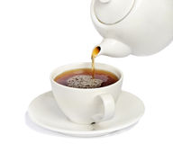 Tea being poured into  tea cup Royalty Free Stock Photography