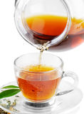 Tea being poured into tea cup royalty free stock images