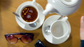 Tea being poured into tea cup. stock footage