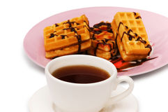 Tea and belgian waffles. Isolated on the white Stock Photos