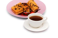 Tea and belgian waffles Stock Photography