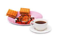 Tea and belgian waffles isolated. On the white Stock Images