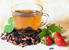 Tea and berries Stock Photography