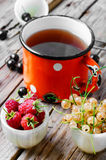 Tea and berries Royalty Free Stock Images