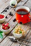 Tea and berries Stock Image
