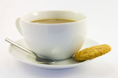 Tea and Biscuit. Cup of tea with single biscuit on a white background Stock Photo