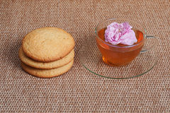 Tea, biscuit and tea rose Royalty Free Stock Photos