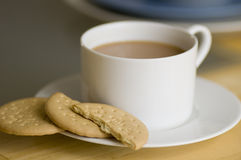 Tea and biscuits. Cup of tea with rich tea biscuits Royalty Free Stock Photography