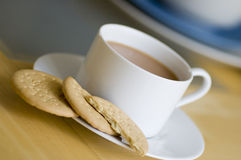 Tea and biscuits. Cup of tea with rich tea biscuits Stock Image