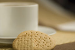 Tea and biscuits. Cup of tea with rich tea biscuits Stock Images