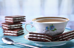 Tea and biscuits. Close up of cup of hot tea and chocolate biscuits Royalty Free Stock Images