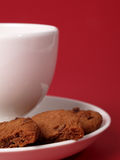 Tea and biscuits. On a red background Royalty Free Stock Image