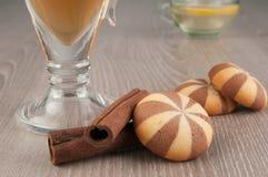 Tea, biscuits and cinnamon Stock Photo
