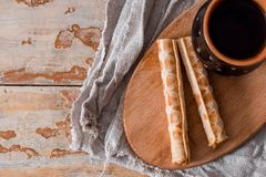 Tea with biscuits crackers on an old wooden board, on a crumpled linen napkin, on a vintage table, top view, wabi sabi series, Cop. Tea with biscuits crackers on stock photos