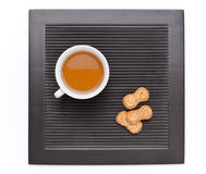 Tea with biscuits on dark background Stock Image