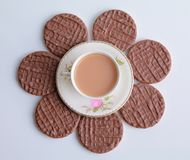 Tea and biscuits flower Stock Photography