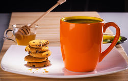 Tea with biscuits. Hot tea with biscuits and honey on a plate Stock Photo