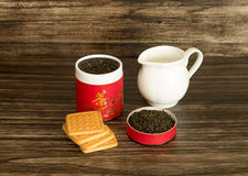 Tea, biscuits and a jar. On a wooden background Stock Image