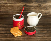 Tea, biscuits and a jar. On a wooden background Stock Images