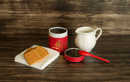 Tea, biscuits and a jar. On a wooden background Royalty Free Stock Photos