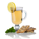 Tea with biscuits, lemon and mint isolated stock photography