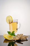 Tea with biscuits, lemon and mint Stock Photo