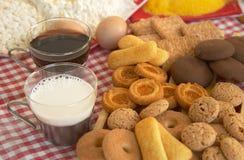 Tea, biscuits, milk, egg Stock Photo