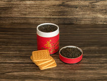 Tea and biscuits. On a wooden background Royalty Free Stock Image