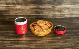 Tea and biscuits. On a wooden background Stock Photography