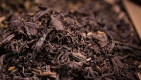 Tea black tea macro photo. Macro photo of black tea, close-up Royalty Free Stock Photo
