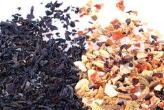 Tea, black versus fruit. Royalty Free Stock Photo