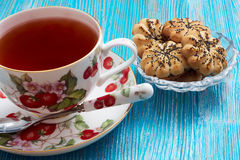 Tea on a blue background. Tea in a porcelain cup on a blue table and cookies Stock Images