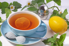 Tea in a blue cup with lemon Stock Photography