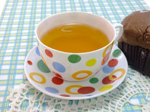 Tea on blue table cloth Stock Photo