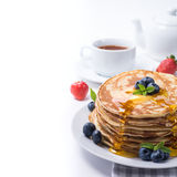 Tea with blueberry pancakes Stock Images
