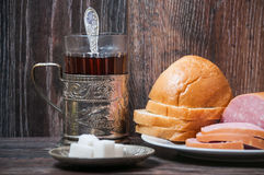 Tea, boiled sausage and bread Royalty Free Stock Photography