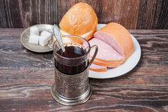 Tea, boiled sausage and bread Royalty Free Stock Images