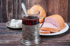Tea, boiled sausage and bread Stock Photos