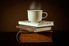 Tea on the book Stock Photo