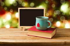 Tea and books with chalkboard over Christmas background Royalty Free Stock Images