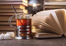 Tea and books. Stock Photos
