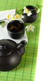 Tea border - teapot, cup, leaves Stock Images
