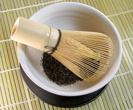 Tea bowl and traditional bamboo wisk2. Bowl with green tea and traditional tea whisk on a bamboo floo Royalty Free Stock Photography